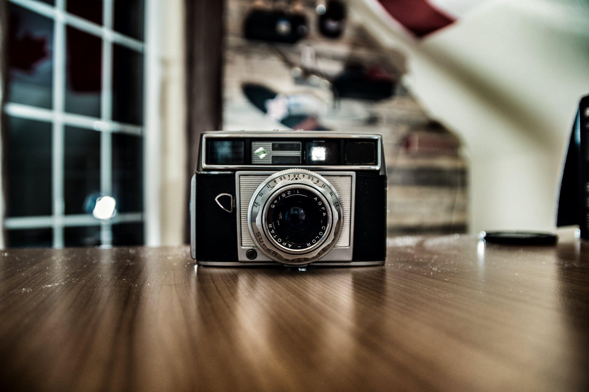 equipment camera close-up indoors studio blur blurred background lens technology old camera