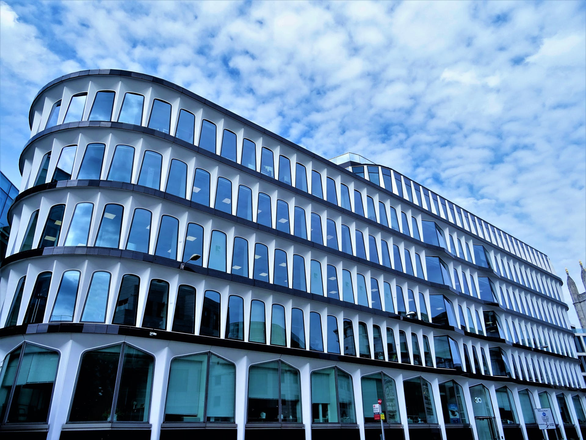 facade architectural design office clouds daylight city glass windows corporate perspective building