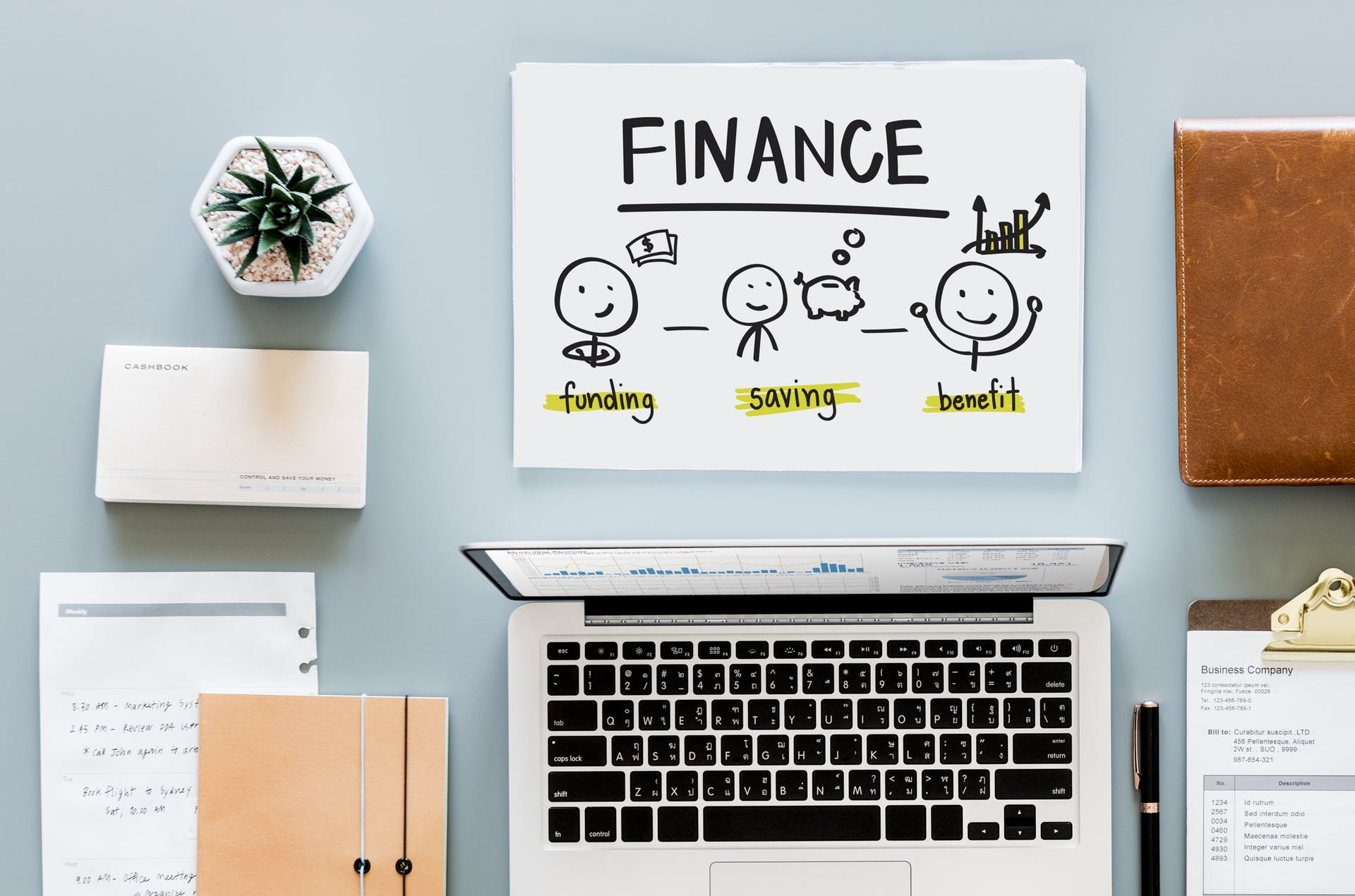 financial business plan modern savings pen indoors office contemporary plant close-up