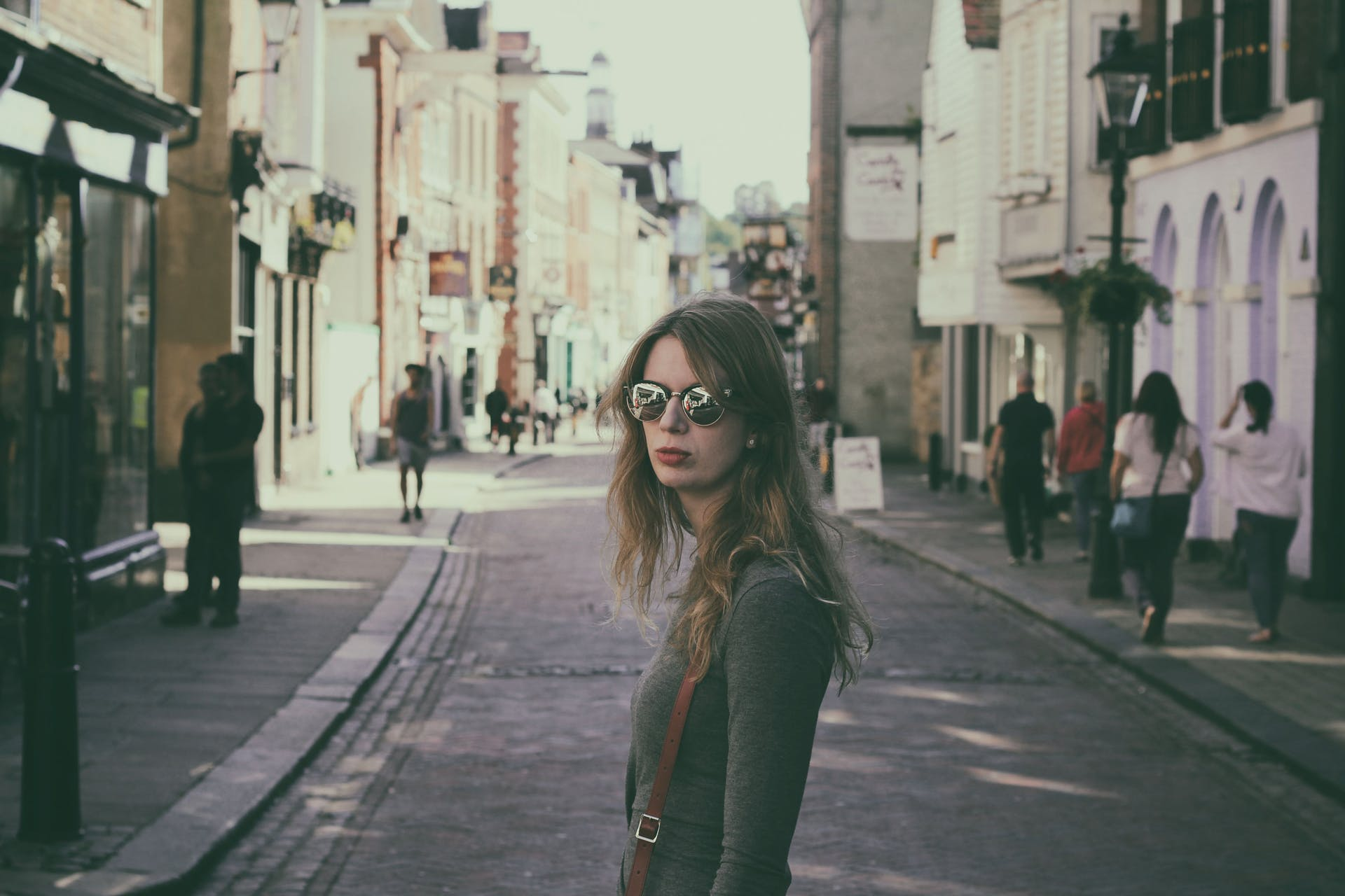 sunglasses person urban pavement downtown city adult buildings girl woman