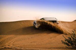 adventure desert dry nature sand dunes daytime vehicle landscape arid sky