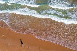 aerial view sea people waves breaking surf water colors top view aerial drone shot young people