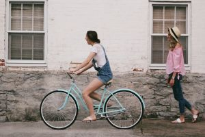 bicycle people wear pavement hat girls women road daylight young