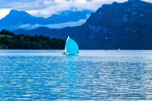 boat mountains recreation ocean water sailing daytime sailboat sea watercraft