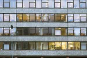 building exterior office block office architecture glass windows warm light office building exterior
