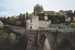 buildings spain arch bridge landmark ancient castle stones clouds tourism architecture