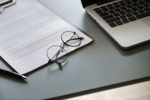 close-up desk financial flatlay eyeglasses network technology work office information
