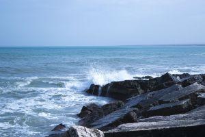 coast sea water nature rocks sky ocean daytime splash water seascape