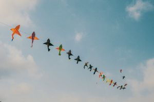 colorful daytime flying kite sky clouds