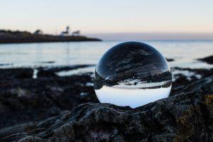 crystal ball seascape sea ocean reflections crystal rocks water sky