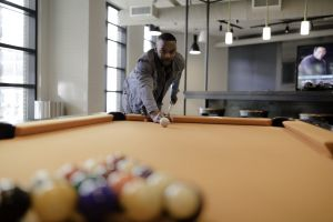 cue room blur man billiards furniture facial expression wear game looking