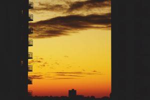 dawn balconies backlit sunset dark sky sunrise
