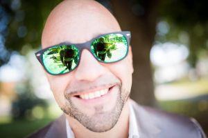 daylight leisure bald man summer eyewear person adult reflection music