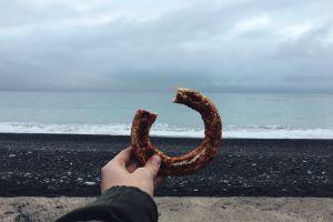 daylight summer landscape sea beach person donut food rock stone