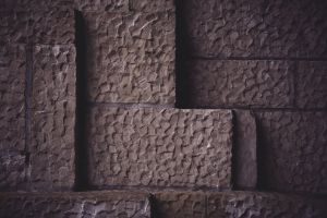 design light and shadow wall chiseled wallpaper architecture rough background stone pattern