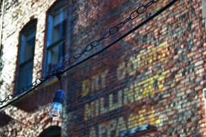 exterior daytime architecture glass items wall wire bricks colors light bulb windows