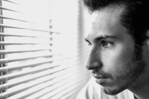 facial expression profile side view music facial hair actor black-and-white light studio window blinds