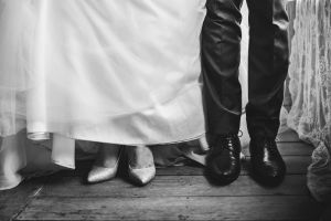 fashion man black-and-white footwear wife couple husband gown wooden floor black and white