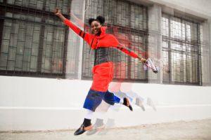 fun model summer style motion fashion model ukraine smiling jumping orange