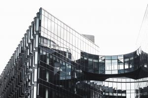 futuristic tall modern architecture reflections contemporary low angle shot offices windows black and white urban