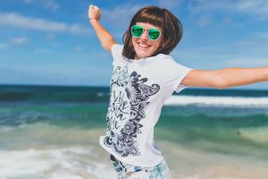 girl daytime ocean beach smiling person sea attractive female woman