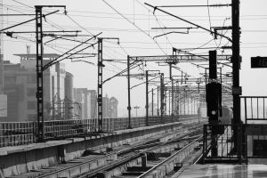 grayscale wires transportation system stoplight monochrome train tracks line train station steel black-and-white