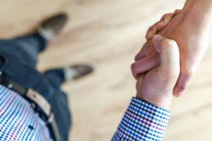 greeting men background indoors handshake deal holding hands welcome formal hands