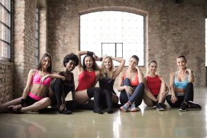 gym pose smiling indoors friendship outfit wear female sitting beautiful