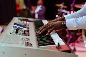 hands fingers wristwatch musician adult instrument close-up blur industry music