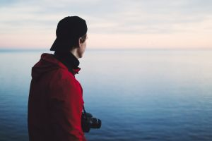 horizon ocean water person cap sea man daytime seascape jacket