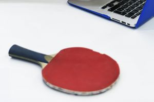 indoors racket laptop technology desk device
