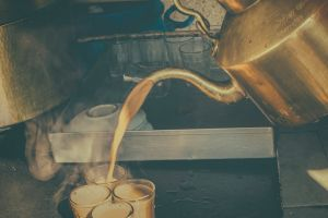 kettle liquid milk tea closeup still life kitchen tools kitchen tea cups plates glass