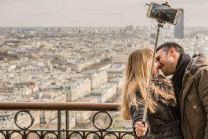 kissing couple city selfie urban wear people buildings man cellphone