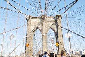landmark cityscape people brooklyn bridge bridge urban buildings architecture high new york city