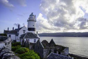 landscape castle seashore sky architecture lighthouse daylight scotland water clouds