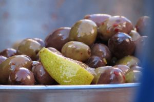 lemon olives oil silver plate market closeup food