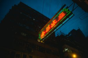 low angle shot evening hongkong building blur neon sign downtown illuminated technology light