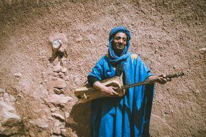 man religion veil adult musical instrument wear street person wall daylight