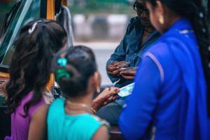 money daytime man urban tricycle taxi street car girls transportation