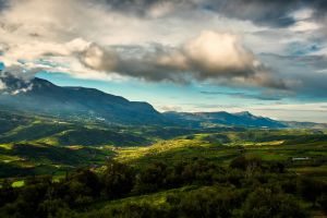 mountains green field landscape after the rain blue sky cloud formation