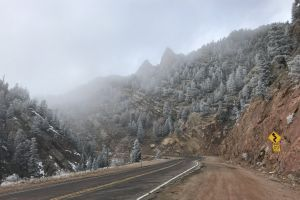 #outdoorchallenge outdoorchallenge trees mountains snow road fog road sign