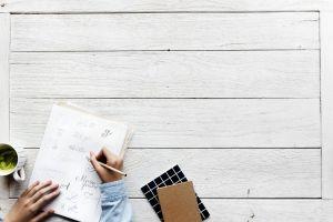 person furniture coffee flatlay desk write hobby indoors handwriting woman