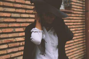 person wear fashion female hat brickwall woman fashionable girl bricks
