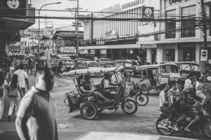 philippines street crowd man motorcycles road traffic motorcyclist tricycle vehicle