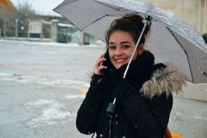 phone young girl snowflakes woman man teenage weather young leisure cold