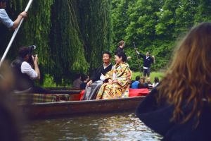 photographer couple water woman wear taking photo kimono boat people watercraft