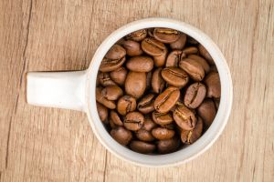 quality white coffee beans roasted close-up macro mug freshness cup wooden