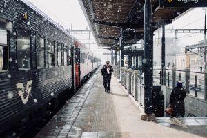 rail daylight commuters railway transportation system steel winter terminal urban snowing