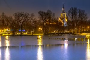 reflections tower park trees building sky evening water night time landmark