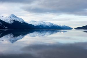 scenic sky nature landscape clouds daylight calm waters snow capped mountains winter high